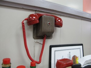 Hamburger King in Shawnee.  You order on these little booth phones!