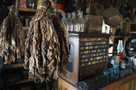 Tobacco leaves, wooden spools of thread